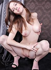 Anita is a spunky girl with bright blue eyes and powder white skin.